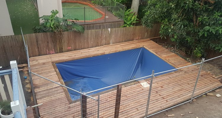 With the decking complete, just the proper pool fence and plumbing was left. Still lots of rain during this period, which actually helped to bring some of the tannins out of the hardwood decking.