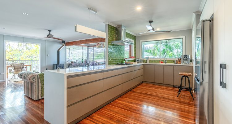 The green tiled splash back is a gorgeous feature of the new kitchen