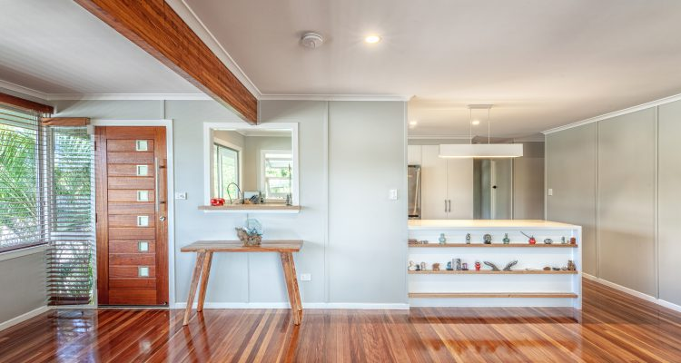 The entry to the house is now warm and inviting, and the timber floors renewed with a sanded and polished finish.