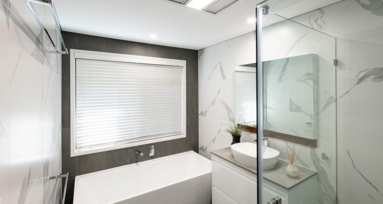 Beauty in its simplicity with stylish modern tiles, frameless shower screens, a modern bath tube, and a floating vanity unit.