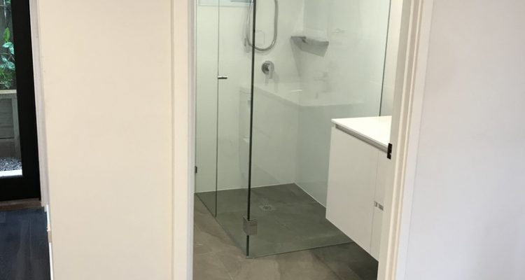 The bathroom is modern and bright, and with the addition of the shower with semi-frameless shower screen, also increases the functionality of this home office to include a guest retreat, Air B&B, or granny flat.