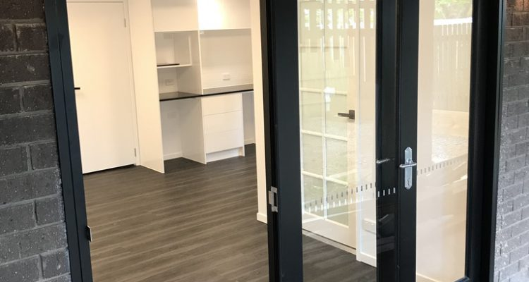 The trifold timber door entrance to the edit suite/home office were painted black to give them a modern edge.