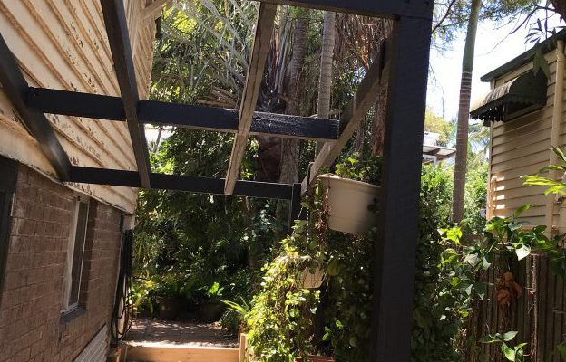 The pergola was constructed at the side entrance to the home office to provide a more attractive entrance through the timber French doors and a relaxing place to take a break from office duties.
